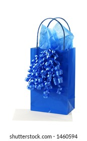 Isolated blue gift bag with tissue paper and curly ribbon