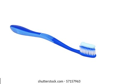 Isolated blue toothbrush with tooth paste on white