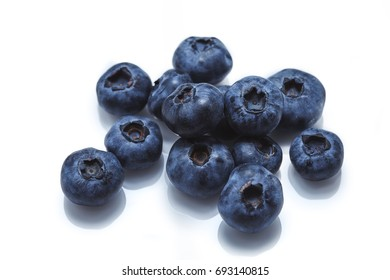 Isolated blueberries on a white background.