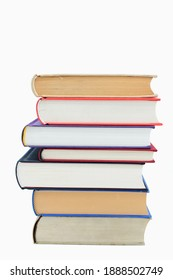 Isolated books, stacked over one another in front of a white background