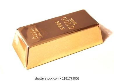 An isolated brick of fine gold over a white background.