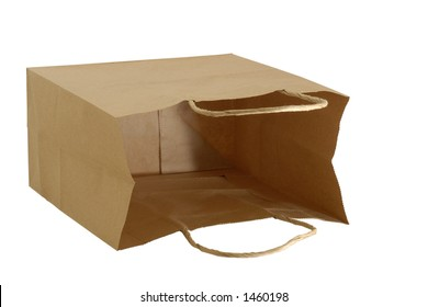 Isolated brown paper gift bag laying on it's side letting you see inside.