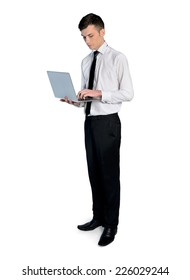 Isolated business man with laptop