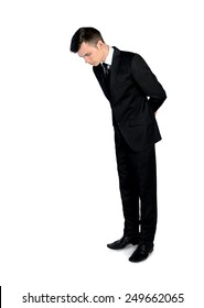 Isolated business man looking down
