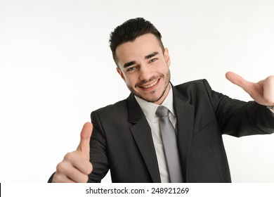 isolated business man in positive attitude with his thumbs up