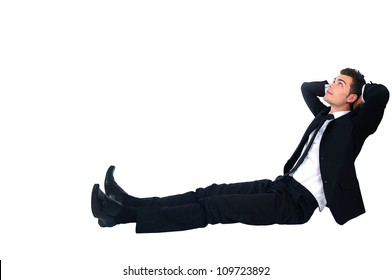 Isolated business man relaxing on white