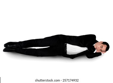Isolated business man sleeping down