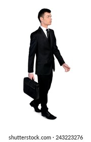Isolated business man walk side view