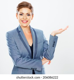Isolated business woman portrait presenting copy space. White background. Caucasian woman.