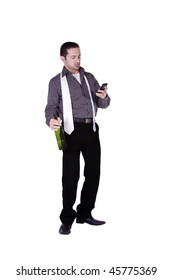 Isolated businessman celebrating with a bottle of drink while texting on his cell phone