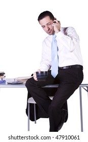 Isolated Businessman At His Desk on the Phone - White Background