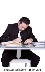 Isolated Businessman At His Desk Working