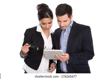 Isolated businesswoman and businessman looking at tablet pc on white background.