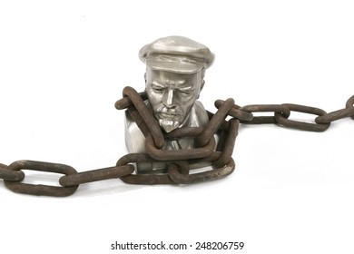 Isolated. Bust of Lenin in a chains