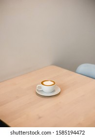 Isolated Caffe Latte cup on the Wooden Table