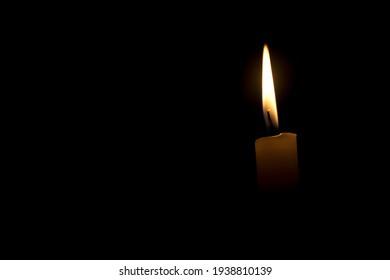 Isolated candle burning with black background