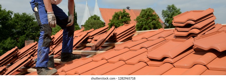 isolated carpenter and roofer. banner for new roofs with plates. panorama construction site worker on summer job.