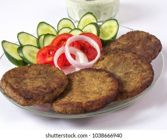 Isolated chapel kabab on white background, Indian or pakistani ramadan food or iftar meal. Spicy shami kabab for Eid dinner.
