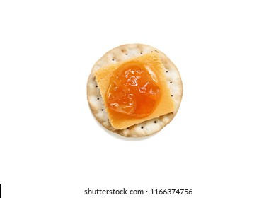 Isolated cheddar cheese and homemade Salted Vanilla Cantaloupe jam on a water cracker over a white background. Clipping path included.