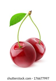 Isolated cherries. Pair of sweet cherry fruits with stems and leaf isolated on white background