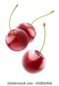 Isolated cherries. Three flying cherry fruits isolated on white background with clipping path