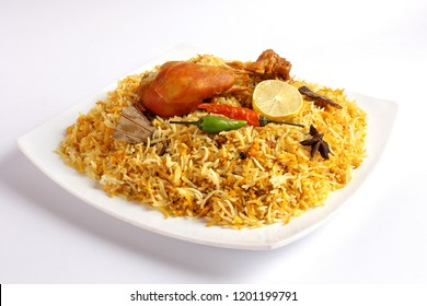 Isolated chicken biryani, Traditional indian food, Spicy fried rice, Ramadan iftar meal, Eid dinner on white background.