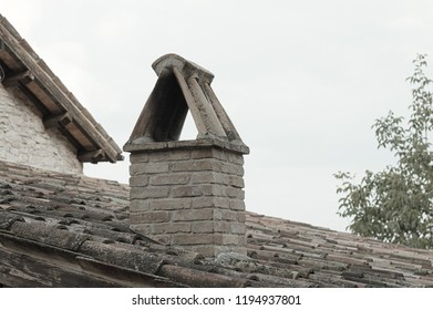 Isolated chimney on the roof of an ancient house (Marche, Italy, Europe)
