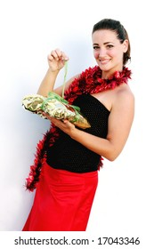 Isolated Christmas portrait of a happy woman decorated in tinsel.