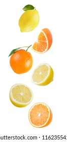 Isolated citrus fruits. Falling orange and lemon isolated on white background with clipping path as package design element and advertising.
