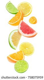Isolated citrus fruits pieces in the air. Sliced orange, lemon, lime, grapefruit and kumquat falling isolated on white background with clipping path