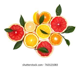 Isolated citrus fruits. Pieces of lemon, lime, pink grapefruit and orange isolated on white background