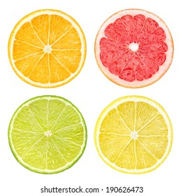 Isolated citrus fruits. Slices of orange, pink grapefruit, lime and lemon fruits isolated on white background