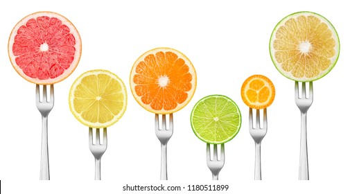 Isolated citrus slices. Pieces of grapefruits, lemon, orange, lime and kumquat on a dessert forks isolated on white background with clipping path