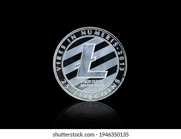 Isolated with clipping path, the silver Lite Coins symbol close up. Lite Coins is one of the digital currency - cryptocurrency driven by blockchain technology.