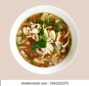 isolated clipping path Spicy fish soup in blow with ingredient of tomyam in white blow
