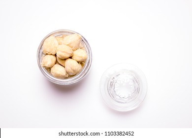 Isolated Close Up a Bowl of Candlenut on a White Background
