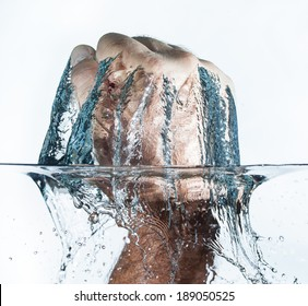Isolated close up of a mans fist being punched through water