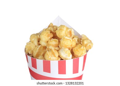 isolated closeup caramel popcorn in a paper cone