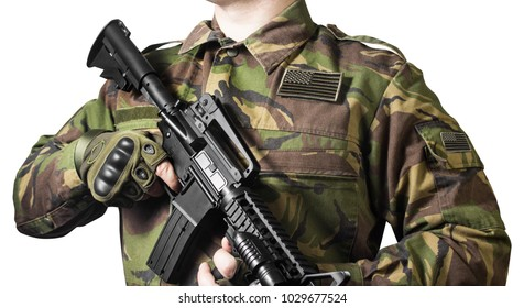 Isolated closeup photo of a  male chest standing in military jacket with automatic rifle and american flag badge.