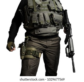 Isolated closeup photo of a male chest standing in brown military jacket with automatic rifle, bulletproof vest and gun in holster front view.