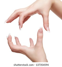 isolated closeup shot of young woman's healthy manicured hands holding imaginary object