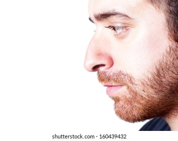 Isolated closeup studio shot of a businessman facing sideways and looking away.