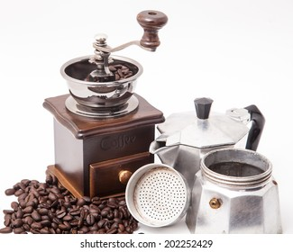 Isolated coffee bean grinder and espresso maker (moka pot) with fresh ground coffee bean