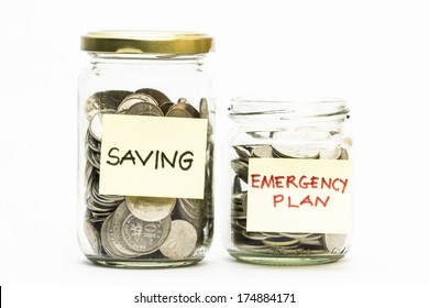 Isolated coins in jar with emergency plan and saving label - financial concept
