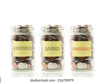 Isolated coins in jar with expenses, savings and emergency label.