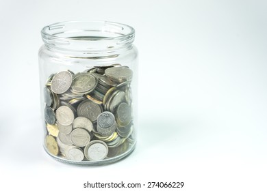 Isolated coins in jar - financial concept