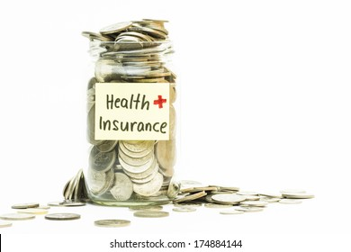 Isolated coins in jar with health insurance label - financial concept