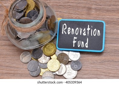 Isolated coins in jar with Renovation Fund word on mini chalkboard - financial concept