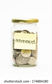 Isolated coins in jar with retirement label - financial concept