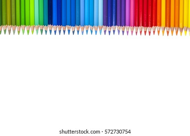 Isolated color pencils in line on white background as a border with copy space.